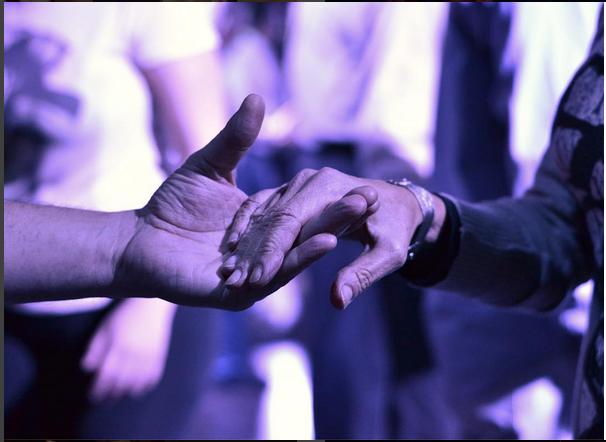 hands toward dancing