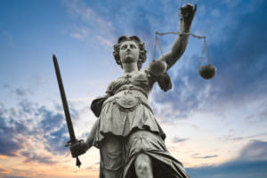 Goddess Themis, good counsel. The sword represents her ability to cut fact from fiction. She can also see the future...